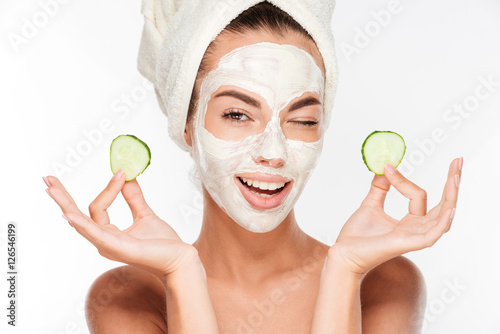 Fotografie, Tablou  Young woman with clay facial mask