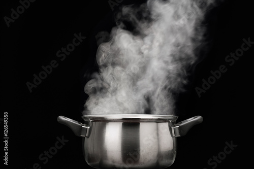 Photo steam over cooking pot