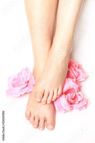Staande foto Pedicure Beautiful feet with perfect spa french nail pedicure