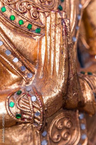 Fotografia, Obraz  Details from buddha statue - namaskara