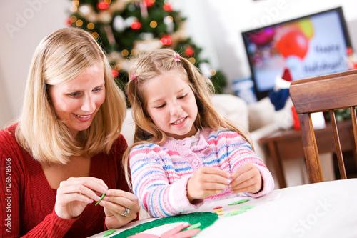 Fotografie, Obraz  Christmas: Having Fun Working On Holiday Craft Wreath