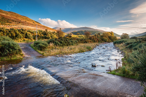 Canvas Prints Hill Ford on College Burn and The Cheviot, from which the hill range takes its name, is the highest point in Northumberland, located in the Anglo-Scottish borders, seen here in autumn from College Valley