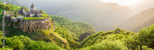 Photo Stands Pistachio Ancient monastery in setting sun. Tatev. Armenia