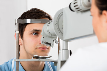 Man Checking Eyesight In Clinic