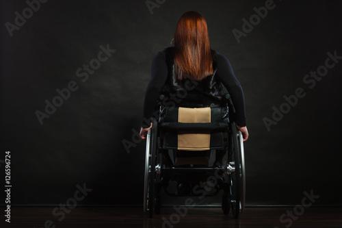 Valokuva  Girl sitting on wheelchair.