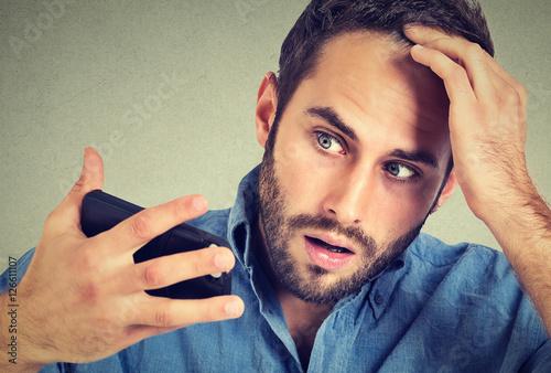 portrait, shocked man feeling head, surprised he is losing hair Canvas Print