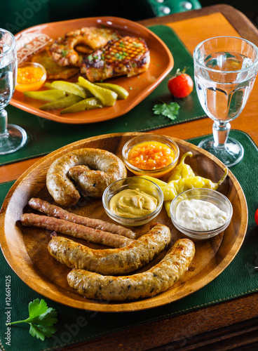 Photo  sausages with sauce