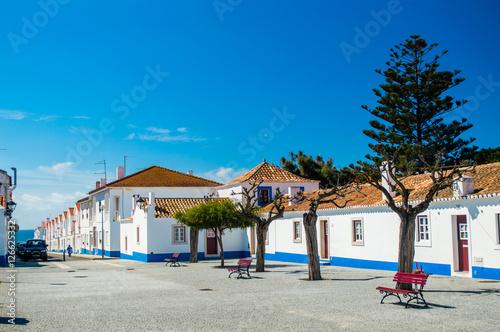 Traditional blue and white Alentejo Portuguese buildings in Porto Covo, Portugal Canvas Print