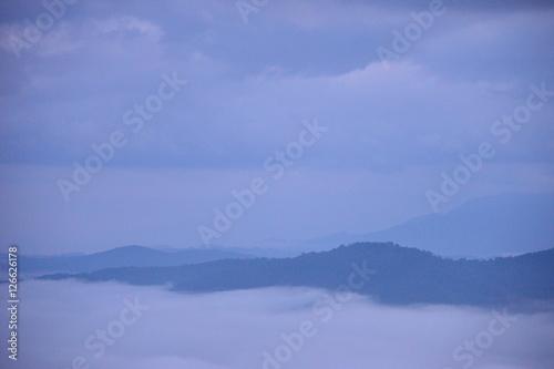 Aluminium Prints Blue Landscape Mountain and mist in the morning at Doi Pha Chu in Si Nan National Park, Nan Province, Thailand