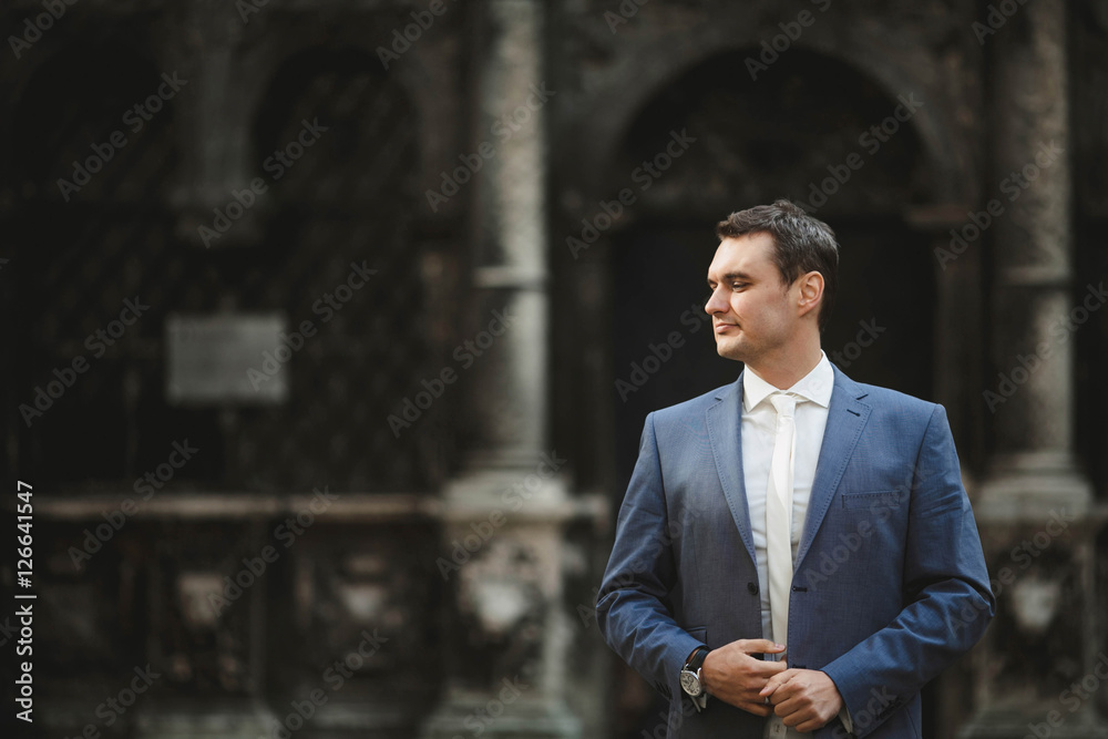 Fototapety, obrazy: groom waiting for his bride near the church