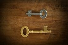 Old Two Keys Placed On A Wooden Floor Loe Key Light.