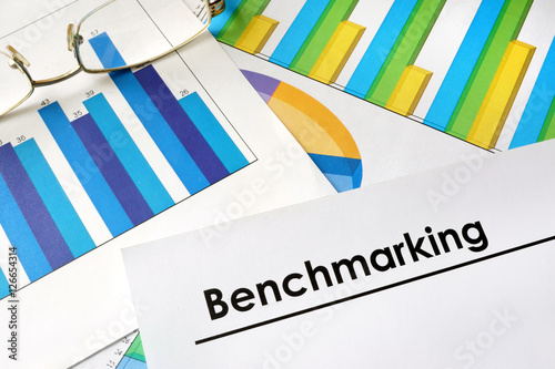 Fotografie, Obraz Paper with words Benchmarking and charts.