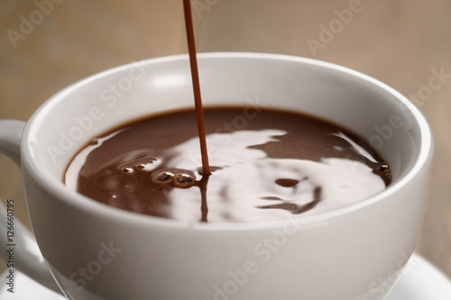 Foto op Plexiglas Chocolade hot chocolate pouring in cup