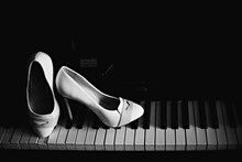 Bride's White Shoes On Piano A...