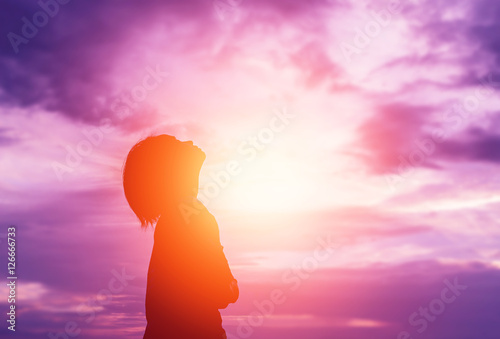 Silhouette of woman praying over beautiful sky background - Adobe ...