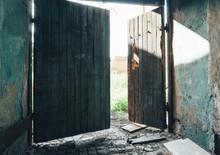 Open Broken Wooden Gate Of Old Abandoned Building
