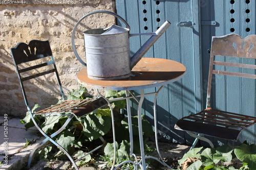 Terrasse De Campagne Table Et Arrosoir Vintage Buy This Stock