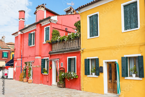 Fotografering  Red and yellow houses in Burano Island (Venice, Italy)