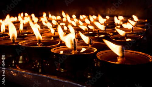 Vászonkép lighting a lamp for peace, Monkey temple Nepal, Monkey temple Kathmandu, Buddhis