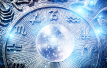 A Blue Crystal Ball With Stars Over Zodiac Background Like Astrology Concept