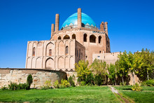 Green Oasis With Trees And Historical 14 Century Blue Domed Mausoleum Dome Of Soltaniyeh