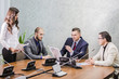 business people having a meeting conference talking about future success of the company. modern city officeinterior, group of four business man working on laptop at meeting together in room