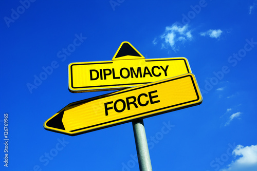 Fotografía  Diplomacy or Force - Traffic sign with two options - political negotiation, deal and treaty vs military power of army
