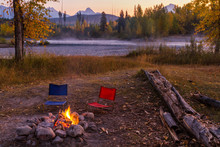 Campfire And Camp Chairs In Glacier National Park