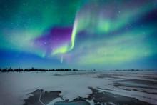 Aurora Borealis Over A Frozen Lake
