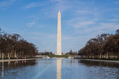 Washington monument in springtime with reflecting pool in the foreground.