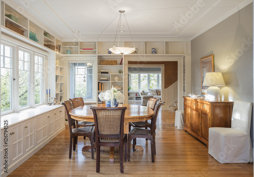 Dining room in luxury home with french doors Poster