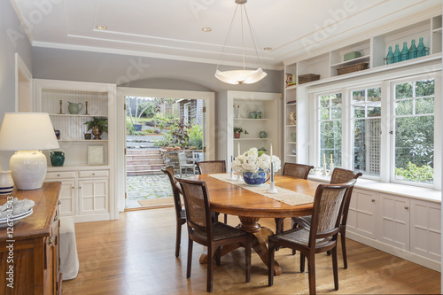 Obraz Dining room in luxury home with french doors - fototapety do salonu