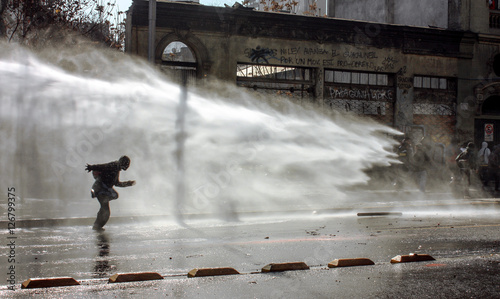 Valokuva  Student's March, police used water cannon against the student protesters in Chile