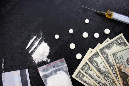 Photo  Drug addiction on black background.