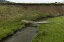 Makeshift Bridge Over A Small River