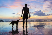 Man And Dog On The Beach Looking At Horizon, Silhouette