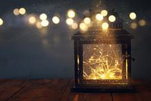 Low Key Image Of Fairy Lights Inside Old Lantern