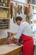 Butcher Preparing Meat In Shop