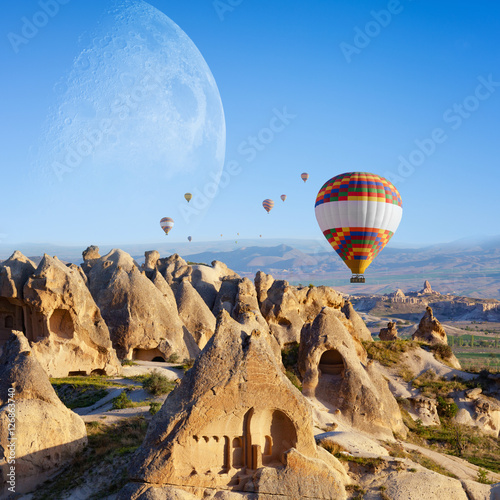 Poster de jardin Paris Hot air ballooning in sunrise in Cappadocia, Turkey. Elements of this image furnished by NASA