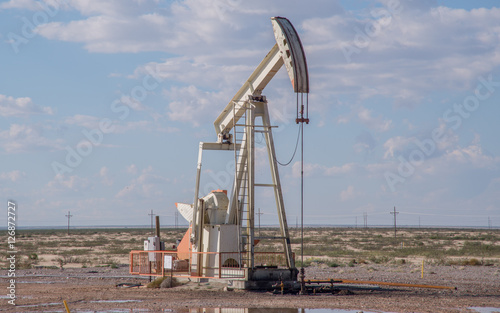 Pump jack pumping oil in west Texas near Midland/Odessa - Buy this