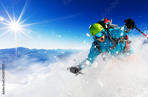 Staande foto Wintersporten Freeride skier on piste running downhill
