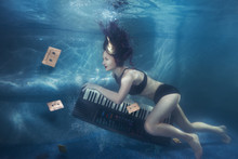 Girl With Piano Under Water.