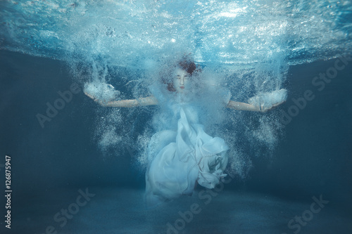 Girl in the pool among the bubbles. Canvas Print