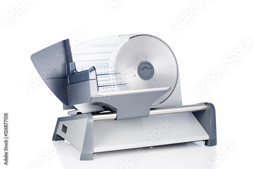 Fotografie, Obraz  Domestic food slicer front view isolated on white background