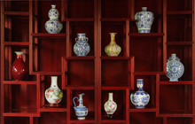 Ancient Chinese Vases In A Traditional Cupboard
