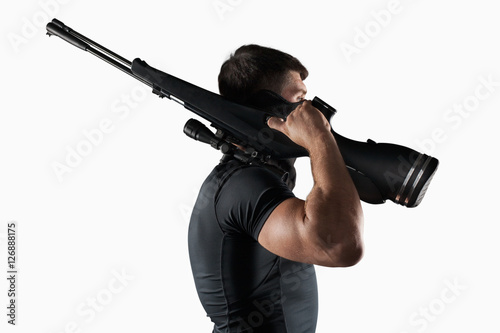 Valokuva  Man with sniper rifle side view isolated