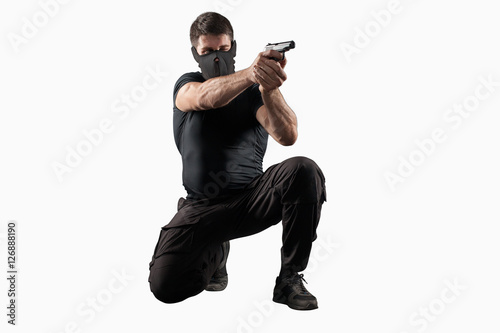 Cuadros en Lienzo Soldier shooting gun isolated on white