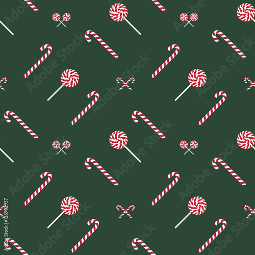 Cotton fabric Bright fun Christmas seamless pattern with candy sticks and lollipops, sweets.