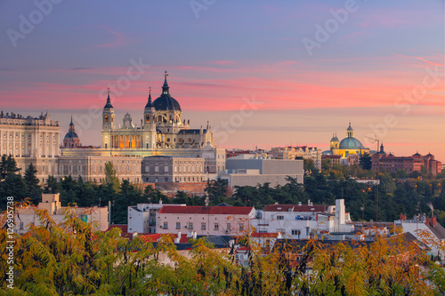 Poster Madrid Madrid. Image of Madrid skyline with Santa Maria la Real de La Almudena Cathedral and the Royal Palace during sunset.