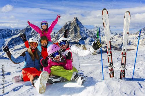 Fotobehang Wintersporten Skiing, winter, snow, sun and fun - family enjoying winter vacat